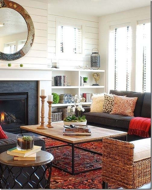 (http://BrandonRugs.com) Hand-knotted Persian Heriz rug is the common-ground meeting place for an eclectic collection of living room furnishings and accessories. All in attendance seem willing to pull together around the rug.