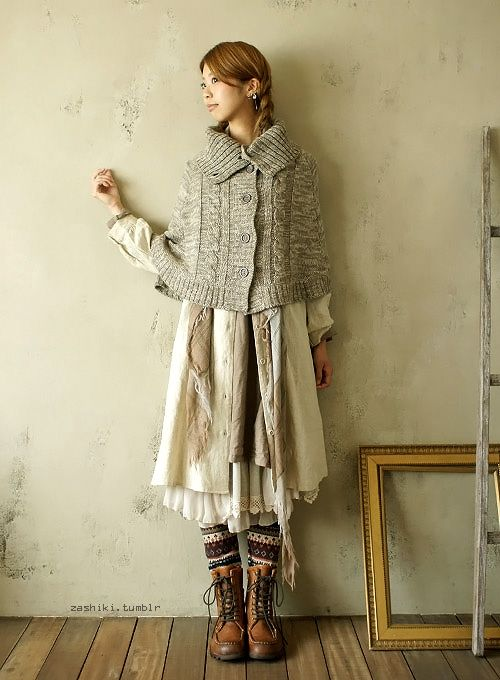 Thick sweater shawls/capes/vests give outfits warmth, build, and the wintery knitted texture.