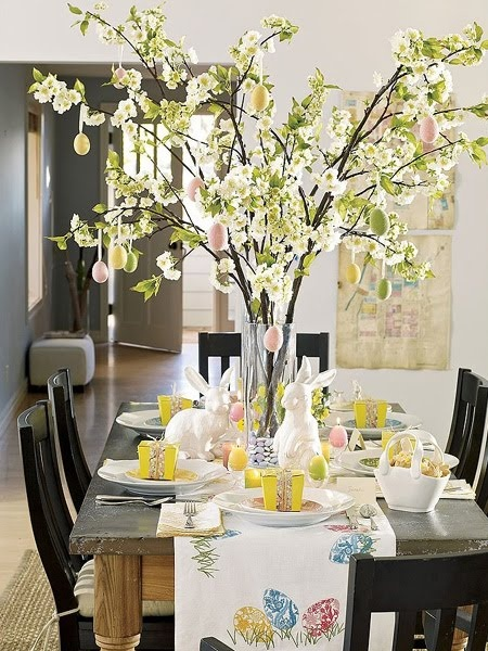 Pretty Easter table--eggs hanging from branches and cute table runner!