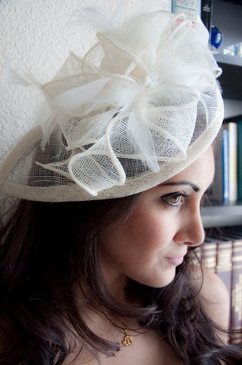 PENNY Ivory Mesh Royal Hat Feather Fascinator Headband for Weddings, Derbys, and Special Occasions. $54.00, via Etsy.