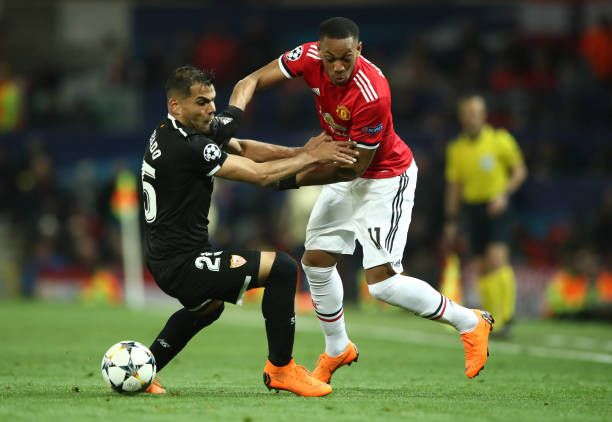 Anthony Martial Of Manchester United Tussles With Gabriel Mercado Of Sevilla During The Uefa Champions League Roun Manchester United Manchester Anthony Martial