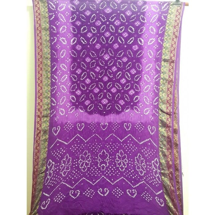 Violet art silk bandhani saree with resham border. The saree has gulti pattern in the body as shown in the pictures. Blouse piece is included.