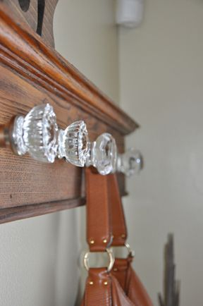 Coat rack from old moulding and glass knobs... Maybe this will be my next project...?