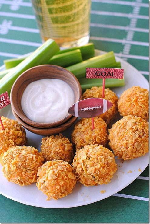 skinny buffalo chicken bites: 3 cups shredded cooked chicken 1/3 cup favorite hot sauce 3 1/2 oz. fat-free cream cheese1 cup shredded cheddar cheese1/4 cup green onions, chopped 1/2 cup all-purpose flour (you won't use all of it) 2 eggs, lightly beaten 3 cups Corn Flakes cereal, crushed