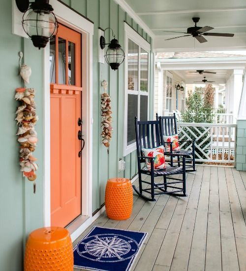 Exterior coastal entry decor idea:http://www.completely-coastal.com/2016/05/the-colorful-coastal-cottages-at-ocean-isle.html  Hanging seashell garlands by the front door... and a nautical door mat.