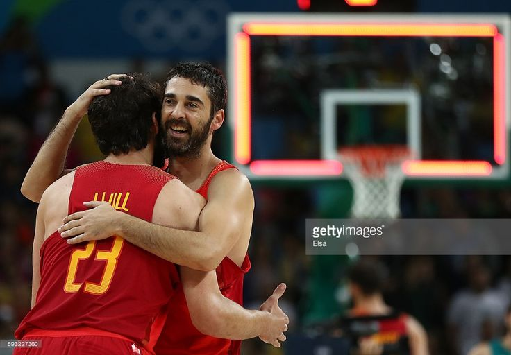 Juan-Carlos Navarro #7 of Spain and Sergio Llull #23 of Spain celebrate winning the Men's Basketball Bronze medal game between Australia and Spain on Day 16 of the Rio 2016 Olympic Games at Carioca Arena 1 on August 21, 2016 in Rio de Janeiro, Brazil.