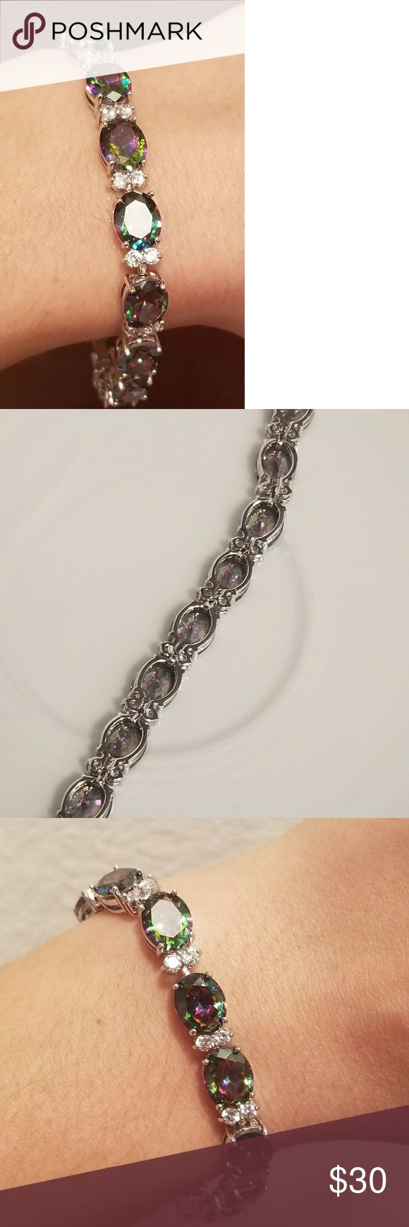 🆕️18K WGF- Mystic Rainbow Topaz Tennis Bracelet JUST IN- BRAND NEW!!  Stunning Mystic (Purple) Rainbow Topaz  Tennis Bracelet in 18K White Gold Filled 😍😍 Size: 18.5 cm Jewelry Bracelets