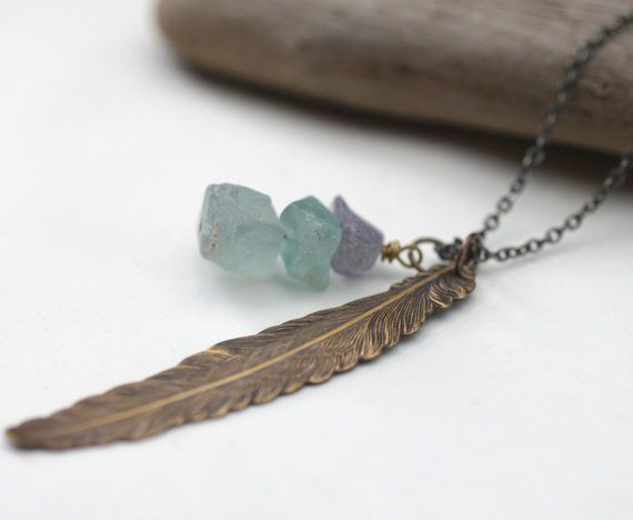This feather necklaces includes raw fluorite stones to promote protection and wholeness as you take flight.