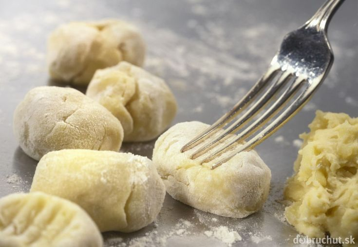 Homemade gnocchi on a flour-covered, kitchen surface