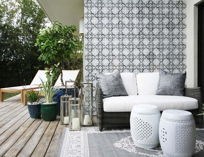 a unique back deck void of color! so many opportunities for plants + flowers! by Errez Design