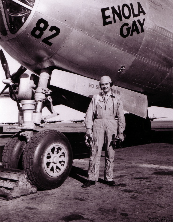 """Col. Paul Tibbetts, Jr., of Miami, Fla., poses in front of his B-29 Superfortress """"The Enola Gay"""" (named for his mother). The Enola Gay is the same plane he piloted when his bombardier dropped the first atom bomb over Hiroshima, Japan."""