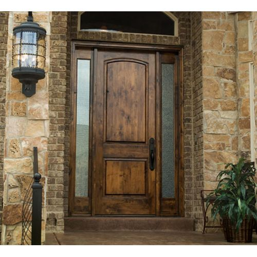 the wood looks so great with the brick and stone exterior what a pretty front door