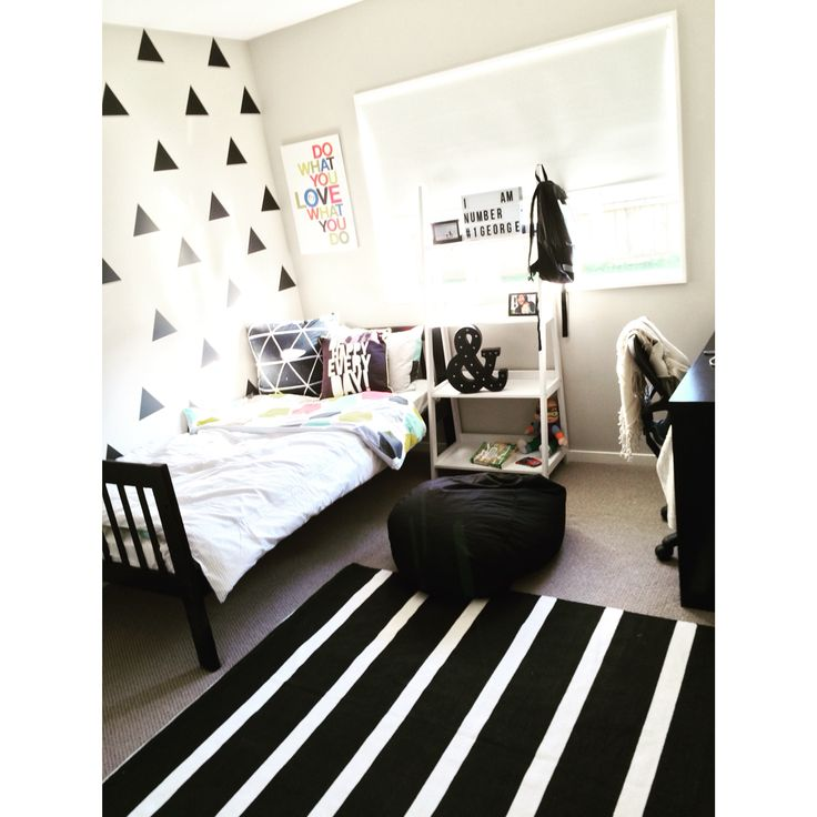 George's room- I was able to decorate his room for under $500. He wanted a black and white room so I painted his bed frame to black and I mixed and match some patterns.