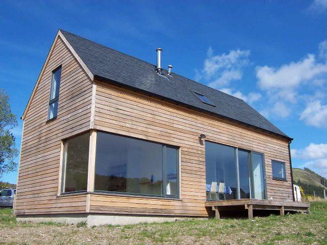 White Farmhouse Exterior Brown Roof