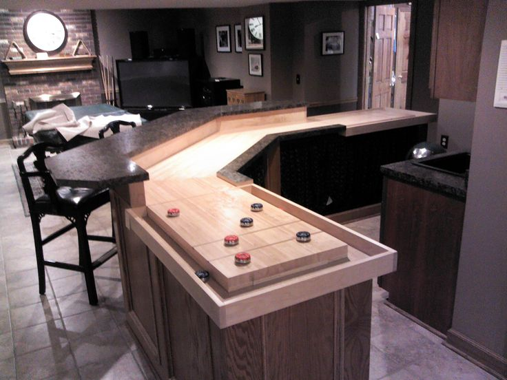 This shuffleboard bar was built with angles.  The bank shots make a more challenging game.