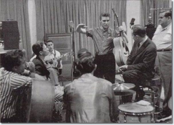 Bill Black, Chet Atkins, Scotty Moore, D.J. Fontana, Elvis Presley, Ben Spear and Steve Sholes - April 14, 1956