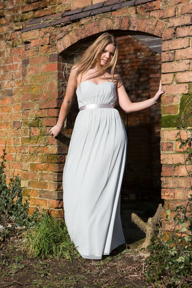 Strapless sweetheart neckline with ribbon satin waist and long flowing skirt.