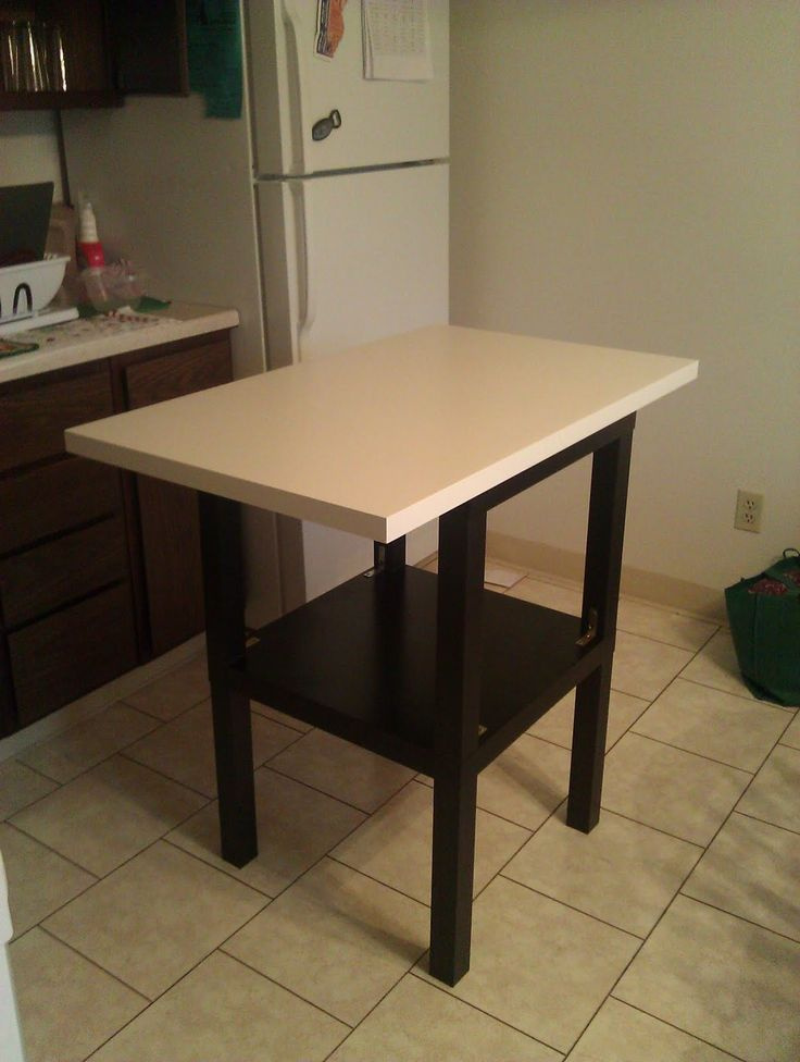 Description: 2 Ikea Lack Side Tables stacked on top of each other, I used 4 L brackets to attach the two together. Then the small cheap vika amon table top glued on top. Cost me about 25 bucks between the side tables, top and hardware.