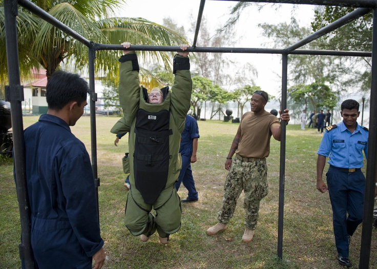 LUMUT, Malaysia (June 16, 2012) Explosive Ordnance Disposal Technician 3rd Class Rendel Mews, assigned to Explosive Ordnance Disposal Mobile Unit (EODMU) 5, performs pull-ups while wearing an EOD bomb suit during demolition materials, procedures and unexploded ordnance training. The event is part of Cooperation Afloat Readiness and Training (CARAT) 2012 Malaysia.  (U.S. Navy photo by Mass Communication Specialist 3rd Class Gregory A. Harden II/Released)
