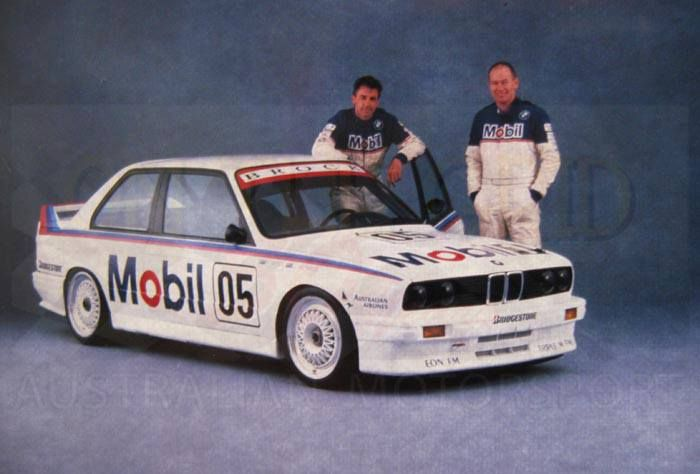 Publicity photo from the launch of the Mobil BMW M3, 1988. Team mates Peter Brock and Jim Richards standing with Brock's 05 BMW M3.