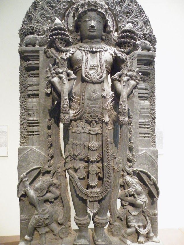 Surya, the Sun God holds Lotus flowers, middle of 13th C.  Karnatha, India. V&A
