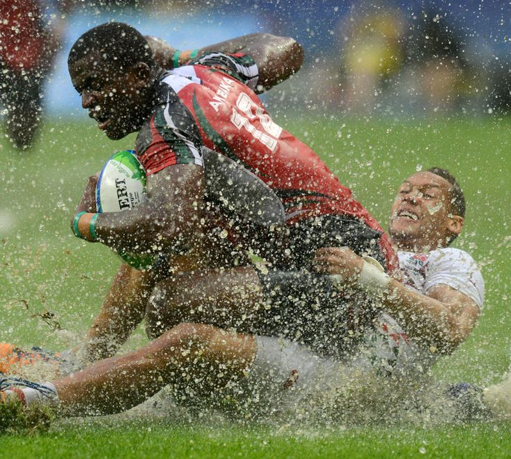 England's Dan Norton tackles Kenya's Willy Ambaka