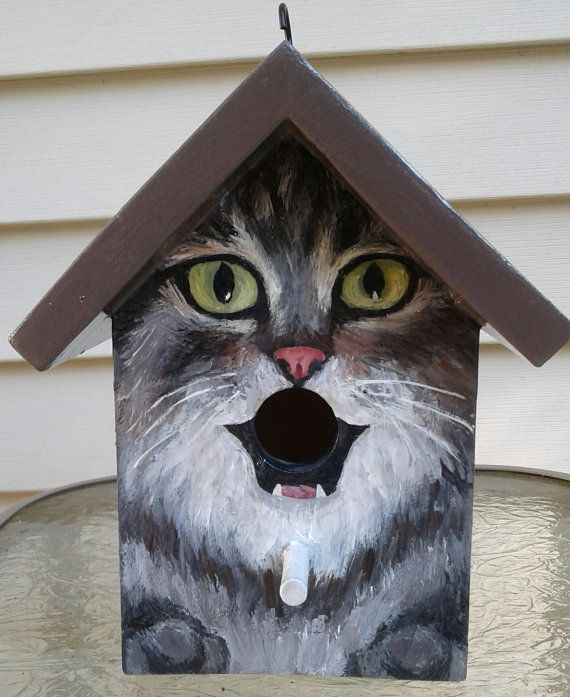 Birdhouse. This bird house is a handpainted EXAMPLE of a grey tabby cat with a chocolate covered roof. Great gift for people who love cats! Various cat breeds or colors may be custom ordered.  **If you would like to order this as a gift, please let me know and I will not include a receipt in the package. You may also request a note to the recipient to be included.  Hand painted wood with acrylics and sealed with several layers of varnish. Hook is attached at the top for hanging.  Measurements...