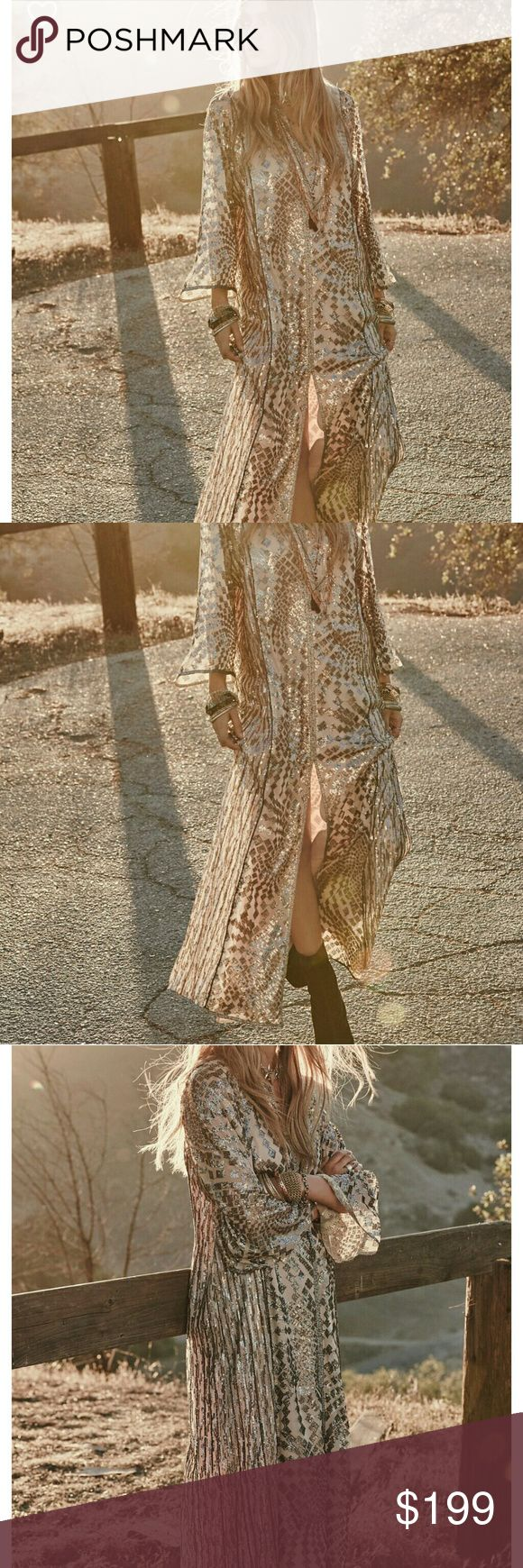 Anna Sui silver maxi dress American made embroidered maxi, adorned with silver sequins that catch the light at each turn. Wide, sheer sleeves,  fully lined.  Dry clean. Bust 20 inches, lenght 54 inches, sleeves length 21 inches. NWOT! Best fit 6/8. Free People Dresses Maxi