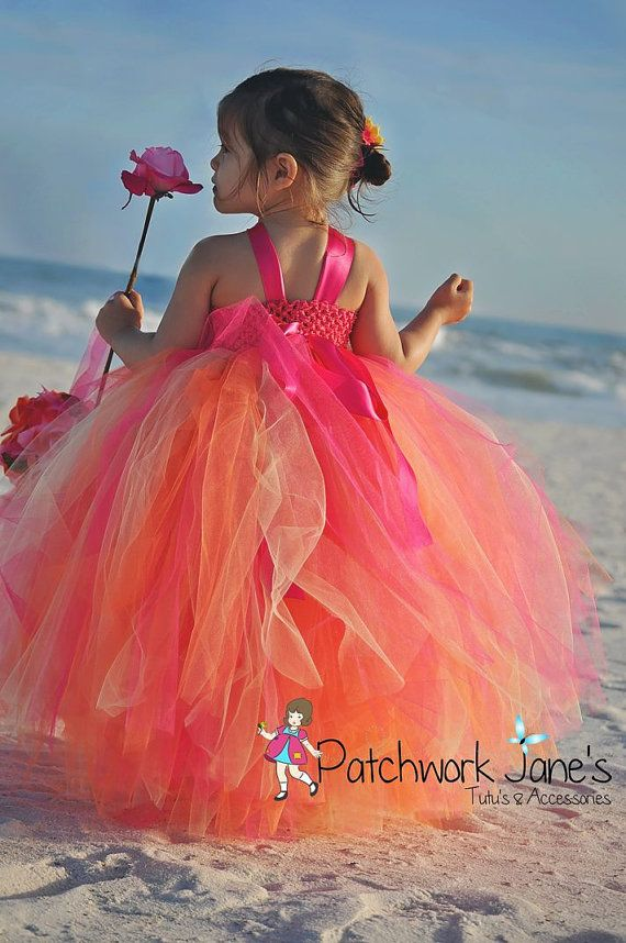 This stunning Flower Girl Tutu Dress comes in colors of orange, baby yellow and Fuchsia Pink. The bodice is adorned with fuchsia shabby flowers