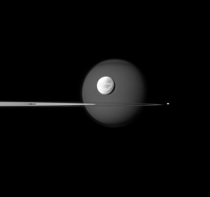 Four of Saturn's moons: Titan in the background, Dione in front of it, Pandora on the right of the image and Pan in the Encke Gap of the A ring. Cassini, September 17, 2011