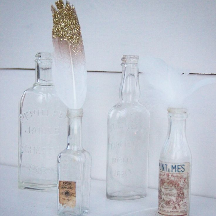 The transparency of the french vintage bottles and the sparkling of the feather. Stunning!!