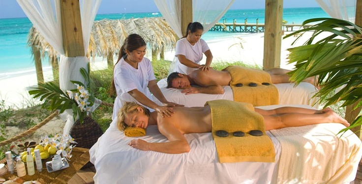 Enjoy a couples massage on the beach with the one you love for Best spa for couples