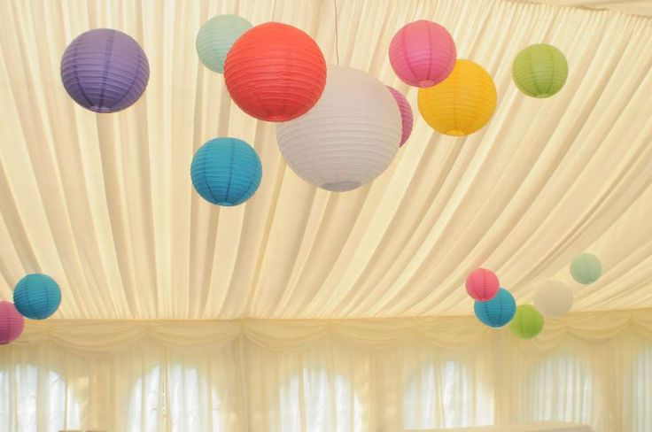 Multi-coloured clusters of lanterns over the dancefloor. All the coloured lanterns are lit and the whites change colour!
