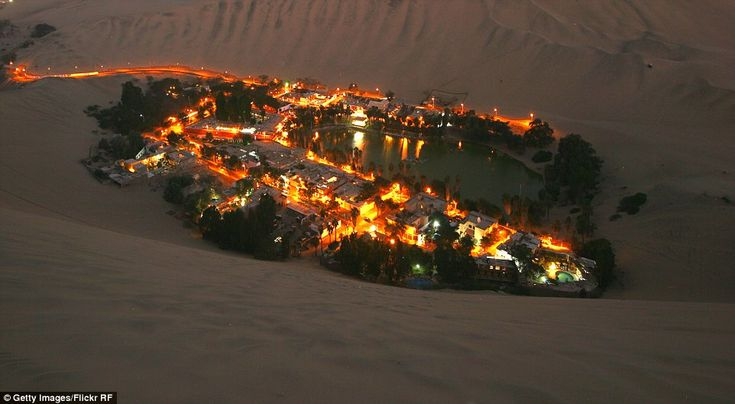 Huacachina at night: magical views of the desert settlement, a flourishing town in the mid...