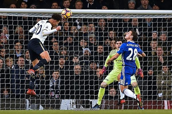 Tottenham Hotspur's English midfielder Dele Alli (L) heads the opening goal past Chelsea's Belgian goalkeeper Thibaut Courtois (C) during the English Premier League football match between Tottenham Hotspur and Chelsea at White Hart Lane in London