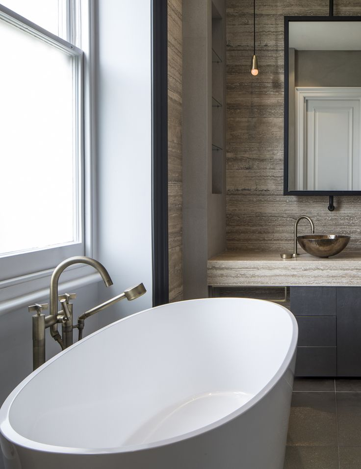 travertine bathroom | mirror | London Apartment by Roselind Wilson Design | Photo by Richard Waite