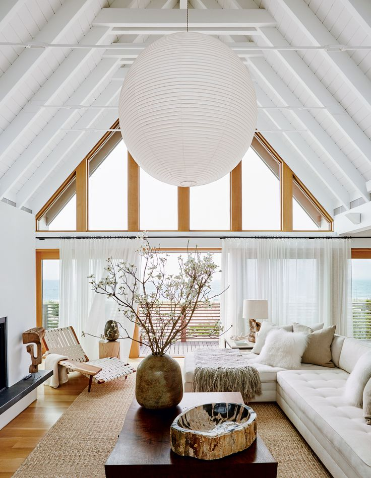 modern white living room with cathedral ceiling.