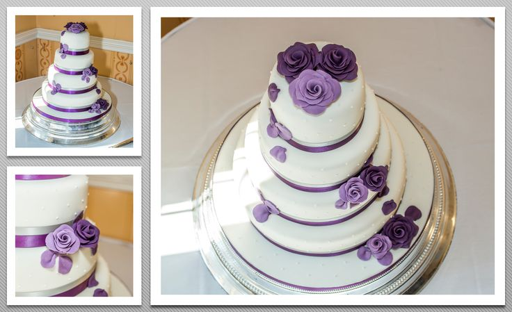 4 tier Wedding cake with purple and lily roses and purple ribbon around each tier.