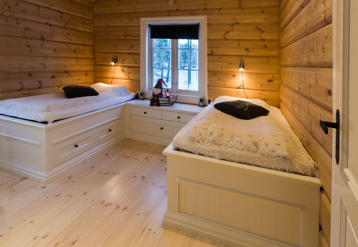 Two beds with shared dresser which doubles as a bedside. Hand-crafted by Os Trekultur.