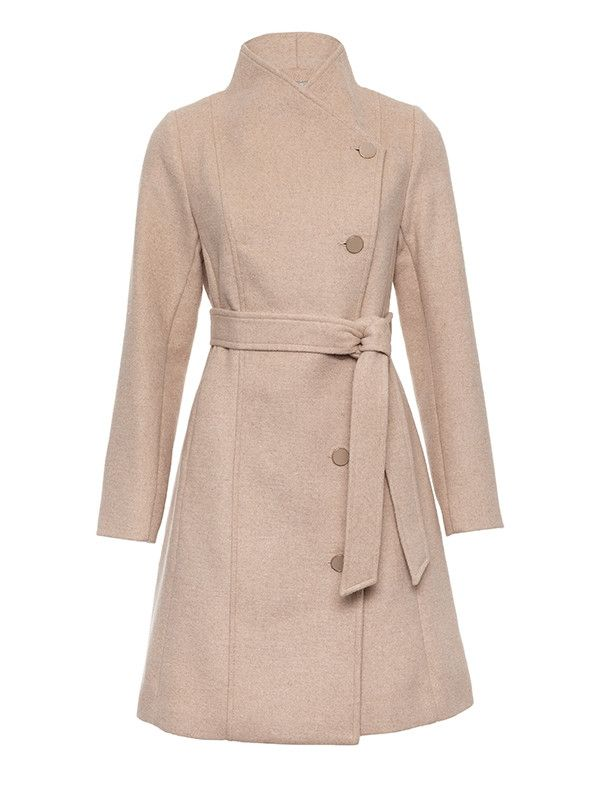 The Fernanda Coat in Camel is a must-have coat for your winter wardrobe. The brushed wool coat has a self-fabric belt and matching buttons, you can wear it done-up for a higher neck or open for a waterfall neckline. The longline coat will keep you warm in winter while still looking elegant and stylish. Features back tab detail and contrast spot lining. The beautiful camel colour will go with everything and is very versatile.