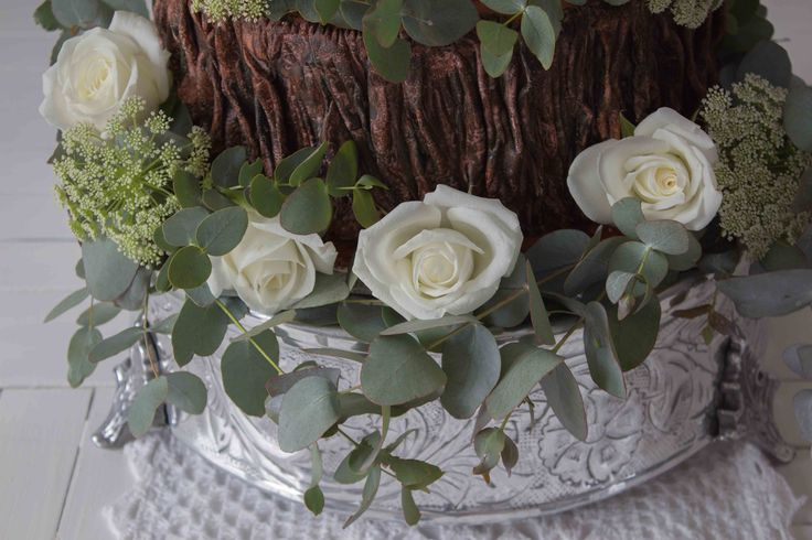 Woodland cake: soft white roses highlighting the fondant bark of the tree stump.