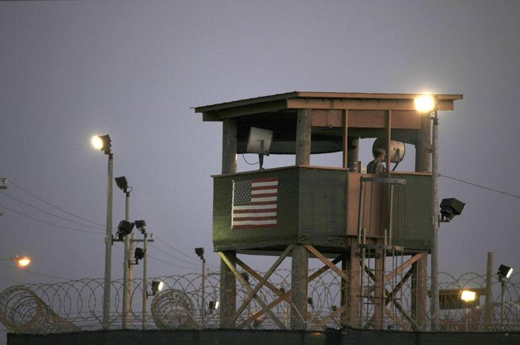 US releases Saudi prisoner from Guantanamo Bay -  In this March 29, 2010 photo, reviewed by the U.S. military, a Guantanamo guard keeps watch from a tower overlooking the detention facility at Guantanamo Bay U.S. Naval Base, Cuba. The transfer of prisoners out of Guantanamo Bay has ground to a halt amid a slow Pentagon approval process.
