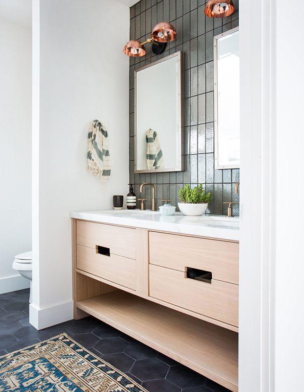 The white oak vanity relates well to the light, neutral tones in the rug. | Photographer: Tessa Neustadt | Designer: Amber Interiors