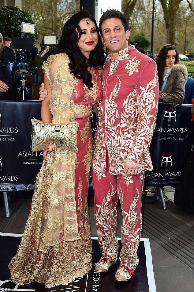 Going all out: Cage fighter Alex Reid stood out from the crowd in a pink velvet suit embroidered with a gold design