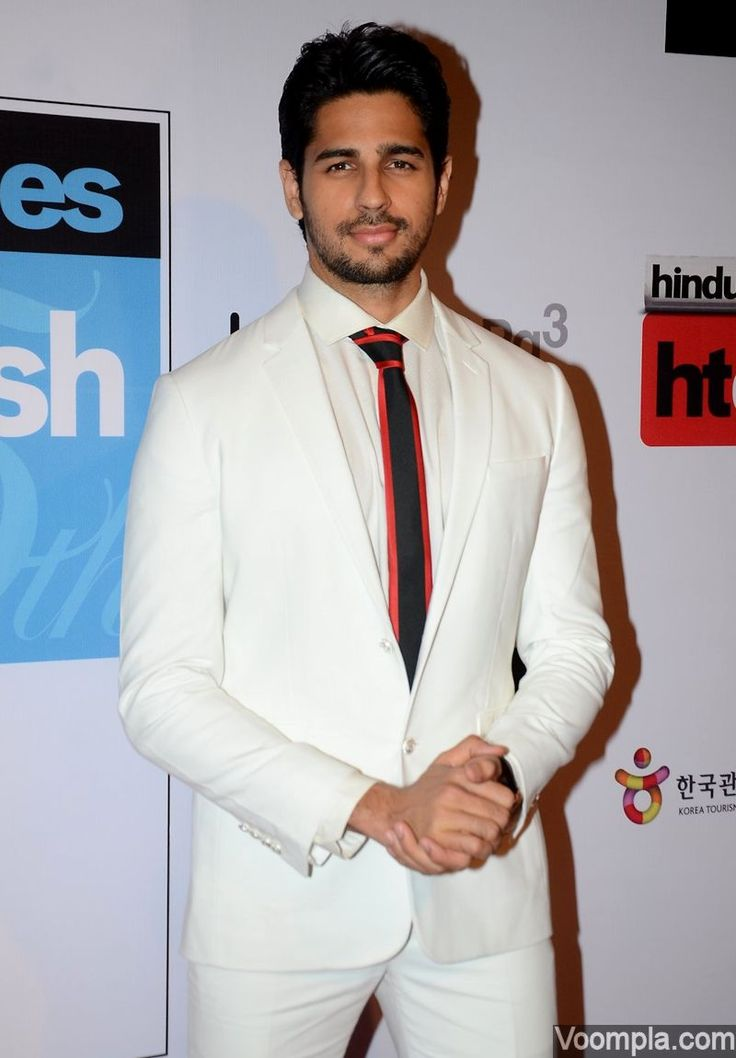 Who says men can't look good in white suits? Sidharth Malhotra rocks a crisp white suit by Dior! via Voompla.com