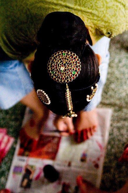 Bharatnatyam performer applying alta (red paint) to her feet  by siddharth bhargava