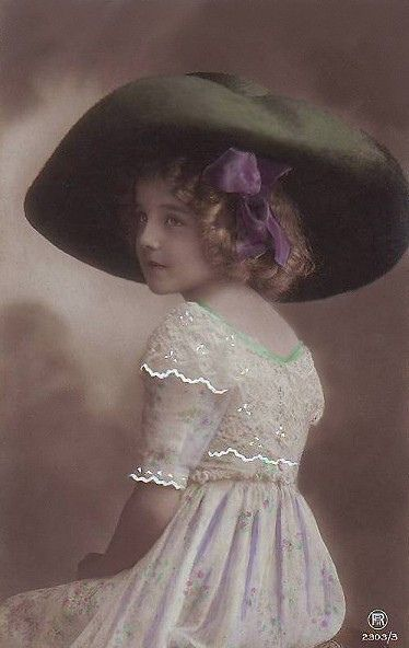 The most photographed child I have seen in the Vintage Postcards....she is lovely!