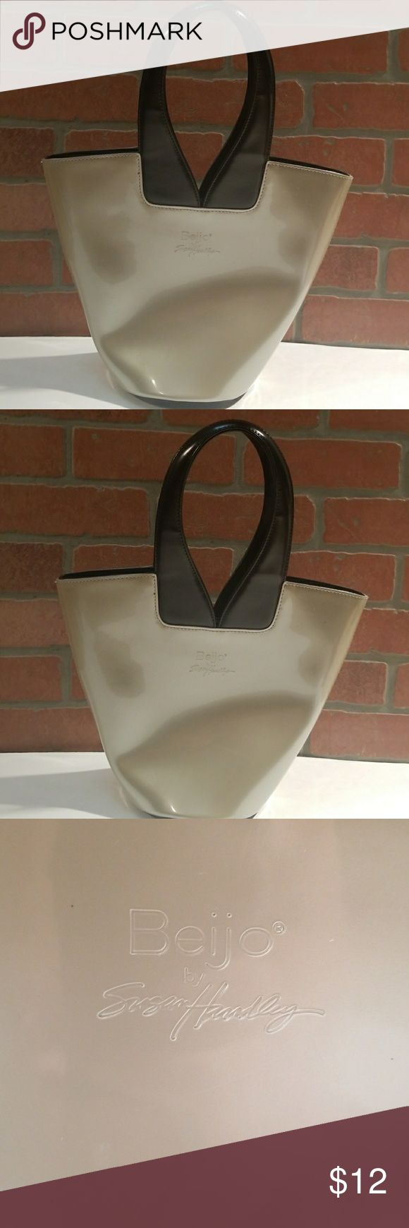 Beijo Handbag Creamy tan with Black Handles Gorgeous bag!! EUC with only a few spots to the back of the bag (Pictured). Interior is in new condition. Beijo Bags Satchels