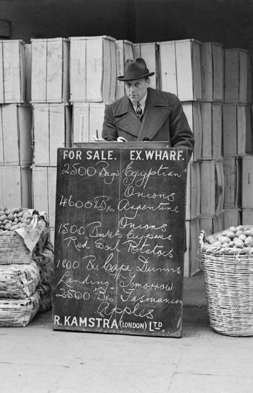 A fruit and vegetable wholesaler displays a list of his goods on a blackboard at Covent Garden Market, London during 1940.