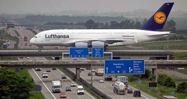This isn't a joke photo of an airplane taking the highway: actually, it's a photo of a plane landing at Liepzig airport as it crosses over t...
